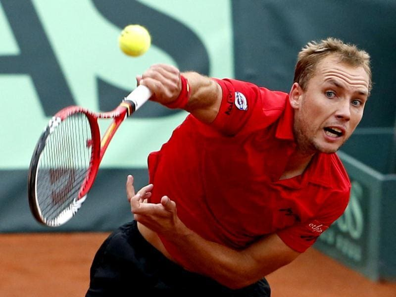 Steve Darcis of Belgium serves to Michael Ryderstedt of Sweden during their Davis Cup World Group play-off tennis match in Brussels September 14, 2012. Reuters