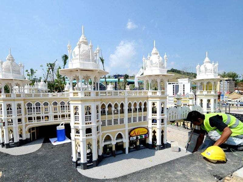 A construction worker works near a miniature of Kuala Lumpur's railway station made of Lego bricks at Legoland Malaysia in Johor Bahru. AFP/Roslan Rahman