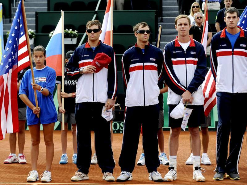 (From right) US tennis players John Isner, Sam Querrey, Mike Bryan and Bob Bryan pose before the first match of the Davis Cup semi-final Spain vs USA at the Hermanos Castro park court in Gijon, northern Spain, on September 14, 2012. AFP Photo