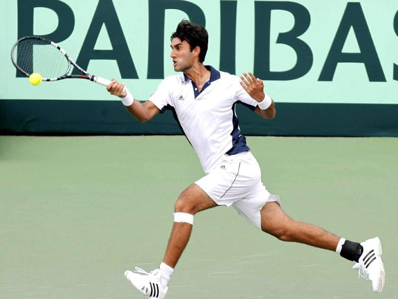 India's Yuki Bhambri returns a shot to New Zealand's Daniel King-Turner, unseen, during their Davis Cup tennis match in Chandigarh, India, Friday, Sept. 14, 2012. AP Photo