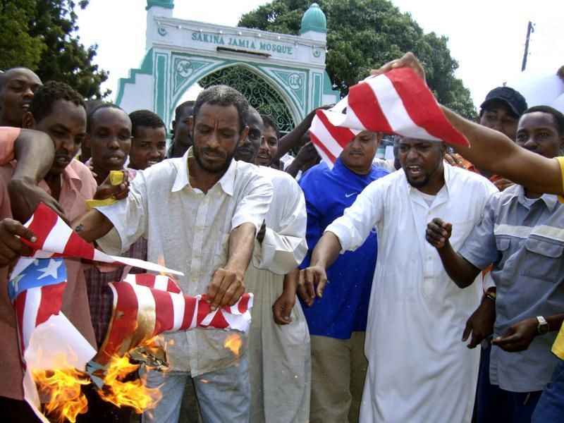 A group of Kenyan muslims burn the US flag in protest over the anti-Muslim film that has spawned mob violence against American embassies across the Mideast, following afternoon prayers outside the Sakina Jamia Mosque in the port city of Mombasa, Kenya. (AP Photo)