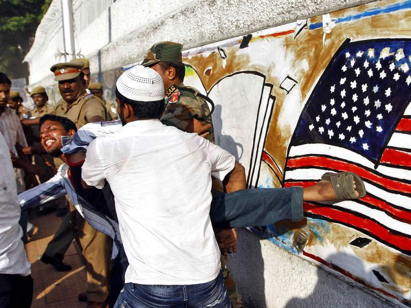 Police officers detain a protester outside the US Consulate-general during a protest by Muslims against a film they consider blasphemous to Islam, in the southern Indian city of Chennai. (Reuters/Babu)