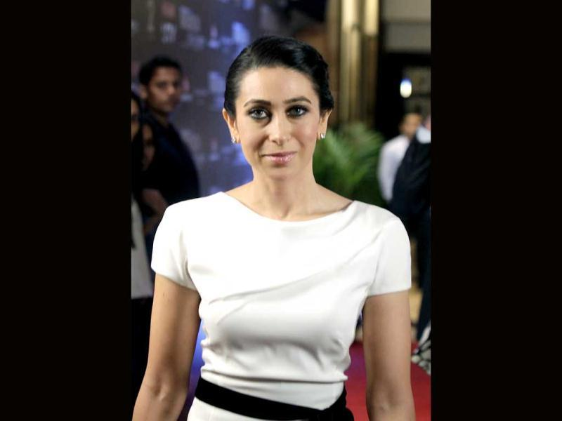 Karisma Kapoor looked very very chic in a simple off-white boatneck dress.
