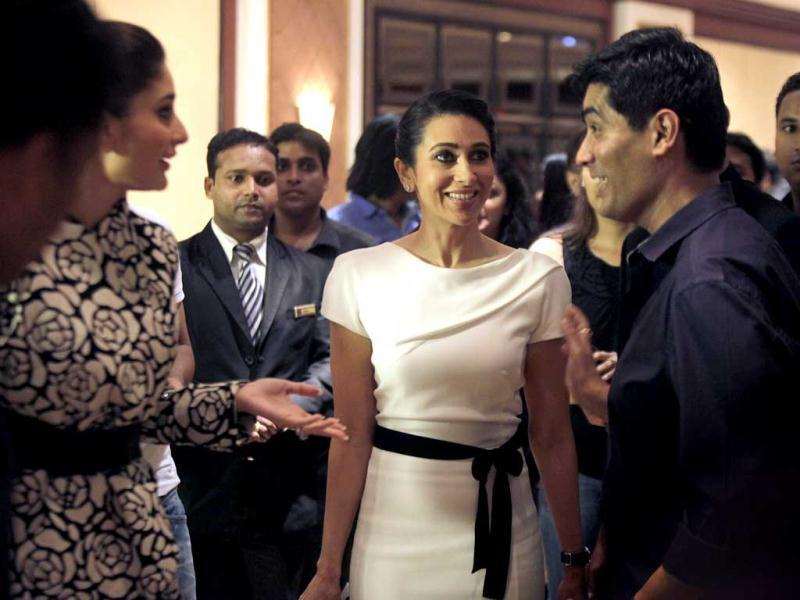 Kapoor sisters, Kareena and Karisma (centre) seem to be engaged in an interesting conversation with designer Manish Malhotra.