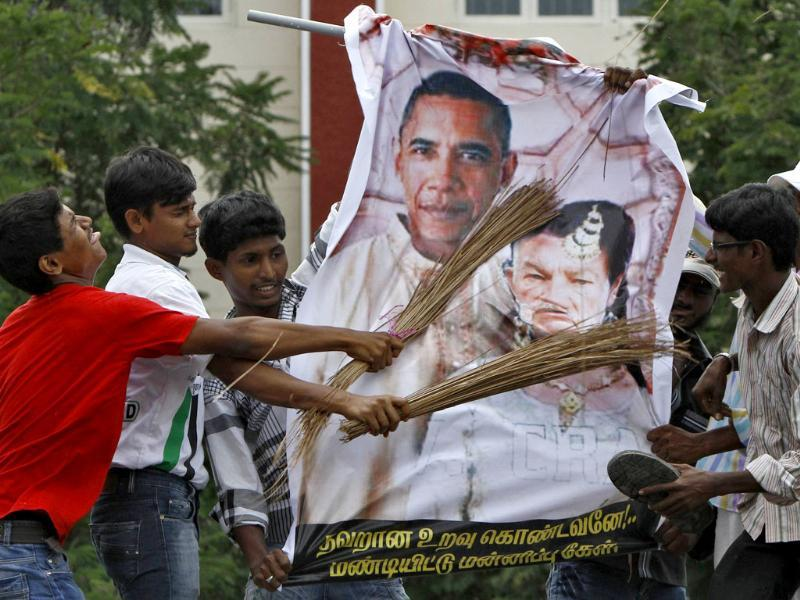 Muslim protesters hit caricatures of US President Barack Obama and Florida pastor Terry Jones with brooms during a protest, against a US-made film they consider blasphemous to Islam, near US consulate-general, in Chennai. Reuters/Babu