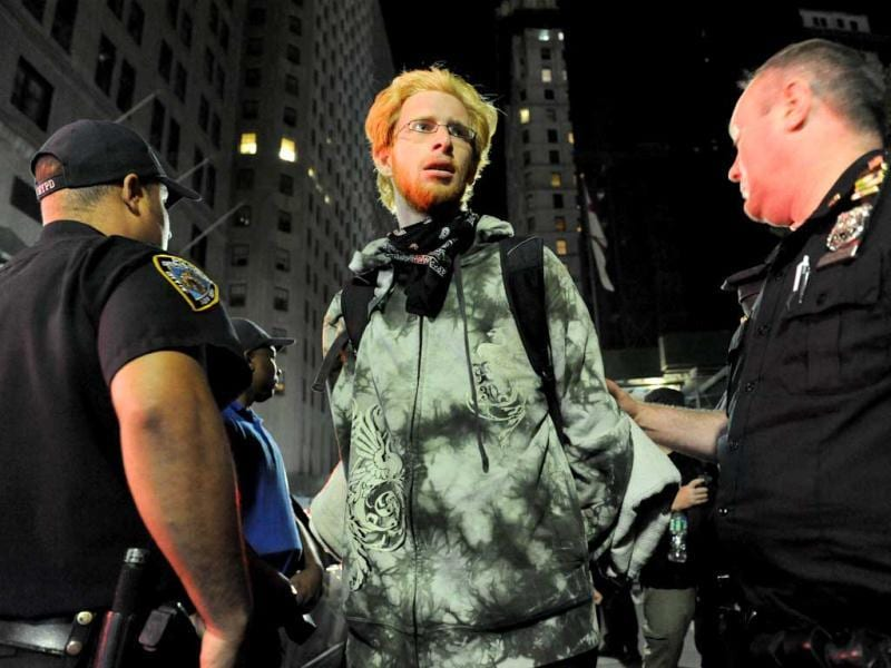 A person associated with the Occupy movement is arrested on a march down Broadway Street in New York enroute to Zuccotti Park. Monday marks the one year anniversary of the Occupy movement. AP photo