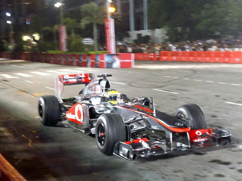 Residents of Mumbai were treated to a night street racing demonstration by champion driver Lewis Hamilton from Mclaren Mercedes. HT/Kunal Patil