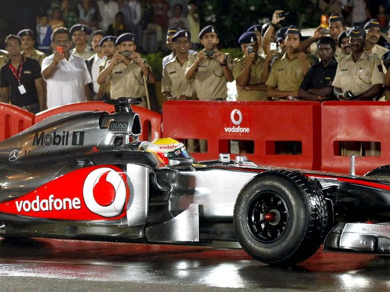 Lewis Hamilton behind the wheel of his Mclaren Mercedes car during the night street racing demo in Mumbai. HT/Kunal Patil