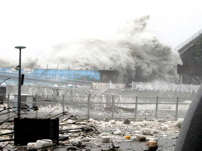 High waves wash over a coastal road as typhoon Sanba hits the country in the southern port city of Yeosu. Typhoon Sanba, packing winds of 155 kilometres per hour, slammed into South Korea bringing torrential rains across the country and shutting down flights and ferry services. (AFP Photo)
