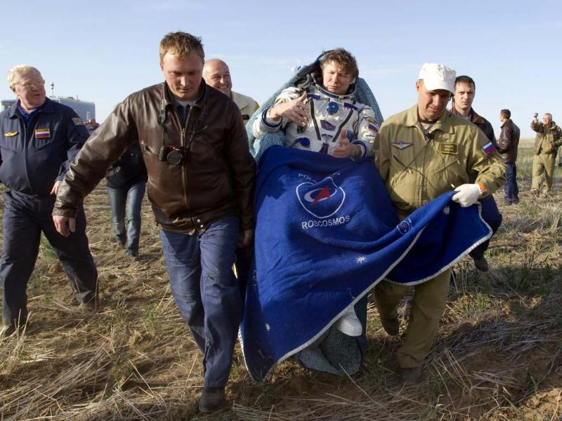 Ground personnel carry International Space Station (ISS) crew member Gennady Padalka shortly after landing near the town of Arkalyk in northern Kazakhstan. AP photo