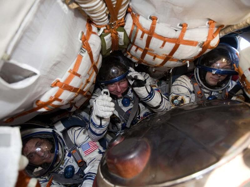 The International Space Station (ISS) crew members, US astronaut Joseph Acaba (L), Russian cosmonauts Gennady Padalka (C) and Sergei Revin sit inside the Soyuz TMA-04M capsule shortly after its landing near the town of Arkalyk in northern Kazakhstan. AFP photo