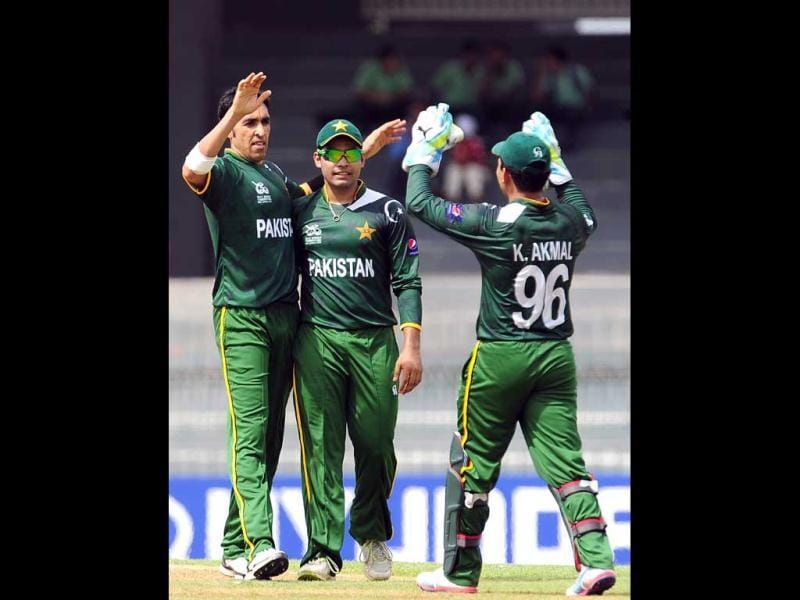 Umar Gul celebrates with teammates the wicket of Gautam Gambhir during a World Twenty20 warm-up match between India and Pakistan in Colombo. AFP/Lakruwan Wanniarachchi