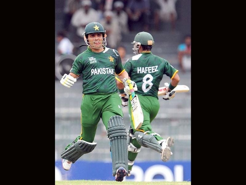 Kamran Akmal and captain Mohammad Hafeez run between the wickets during the World T20 warm-up match between India and Pakistan in Colombo. AFP/Lakruwan Wanniarachchi
