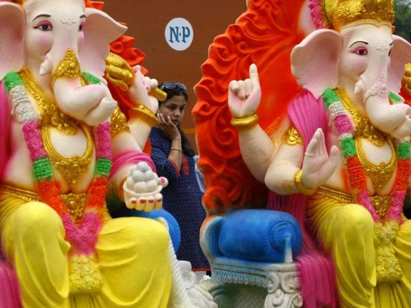 A devotee looks at idols of Lord Ganesha New Delhi. The 10-day-long Ganesh utsav is celebrated with great pomp and grandeur across the country, especially in Mumbai. HT Photo/Raj K Raj