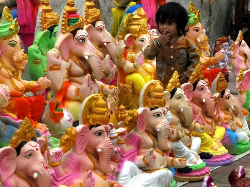 Idols of Lord Ganesha are on display for sale in New Delhi. The 10-day-long Ganesh utsav is celebrated with great pomp and grandeur across the country, especially in Mumbai. HT Photo/Raj K Raj