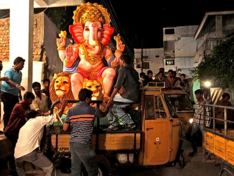People load a giant idol of Lord Ganesha onto a truck in Hyderabad. The 10-day-long Ganesh utsav is celebrated with great pomp and grandeur across the country, especially in Mumbai. AP/Mahesh Kumar A
