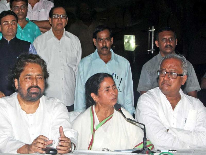 West Bengal chief minister Mamata Banerjee with party leaders interacts with media at the end of party emergency meeting in Kolkata. (PTI Photo by Swapan Mahapatra)