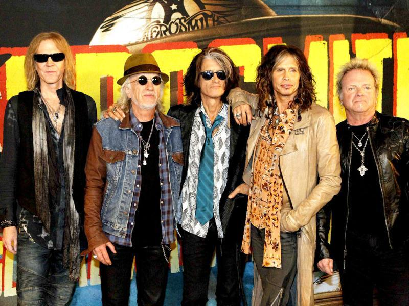 Rock band Aerosmith (L-R) Tom Hamilton, Brad Whitford, Joe Perry, Steven Tyler and Joey Kramer pose while promoting their upcoming album Music from Another Dimension! in West Hollywood, California. Reuters Photo