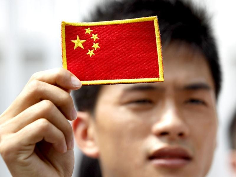 A Chinese protestor holds a Chinese national flag during an anti-Japan protest on disputed islands, called Senkaku in Japan and Diaoyu in China, outside the Japanese Embassy in Kuala Lumpur. AP Photo