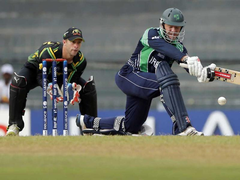 Niall O'Brien, right, plays a shot in front of Australian wicketkeeper Matthew Wade during their ICC Twenty20 Cricket World Cup match in Colombo. AP Photo