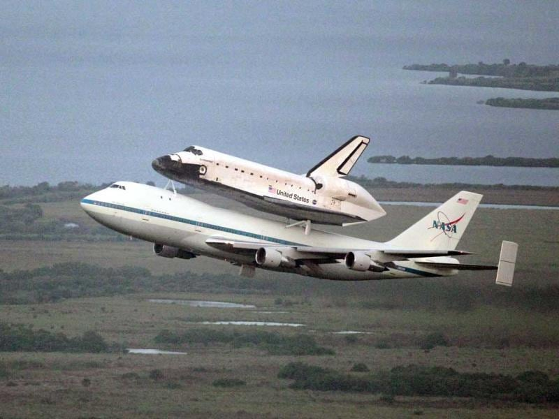 Space shuttle Endeavour, bolted atop a modified jumbo jet, makes its departure from the Kennedy Space Center in Cape Canaveral, Florida. (AP Photo/John Raoux)