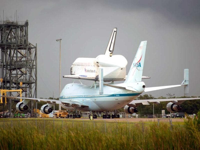 This NASA photo shows Space shuttle Endeavour atop NASA's Shuttle Carrier Aircraft, or SCA, at the Shuttle Landing Facility at NASA's Kennedy Space Center on in Cape Canaveral, Florida. This is the final ferry flight scheduled in the Space Shuttle Program era. AFP/Nasa
