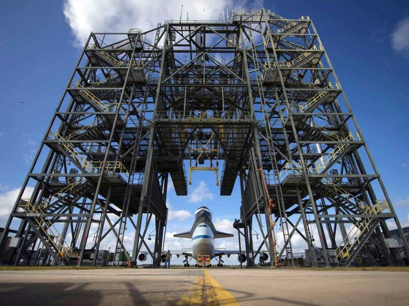Space shuttle Endeavour, atop NASA's Shuttle Carrier Aircraft, is moved back into the Shuttle Mate-Demate Device at the Kennedy Space Center Shuttle Landing Facility in Cape Canaveral, Florida. (Reuters/Nasa)