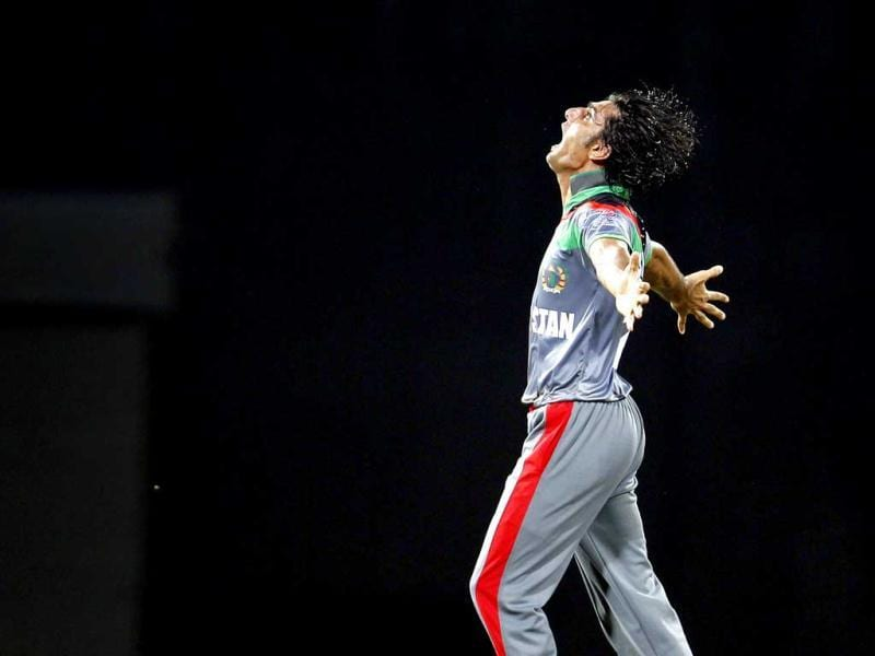 Afghanistan's Shapoor Zadran celebrates the dismissal of Virender Sehwag during the ICC T20 World Cup cricket match between India and Afghanistan at R Premadasa Stadium in Colombo, Sri Lanka. HT/Ajay Aggarwal