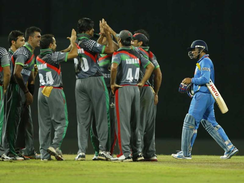 Afghanistan teammates celebrate the wicket of Virender Sehwag, right, during their ICC Twenty20 Cricket World Cup match in Colombo, Sri Lanka. AP/Eranga Jayawardena