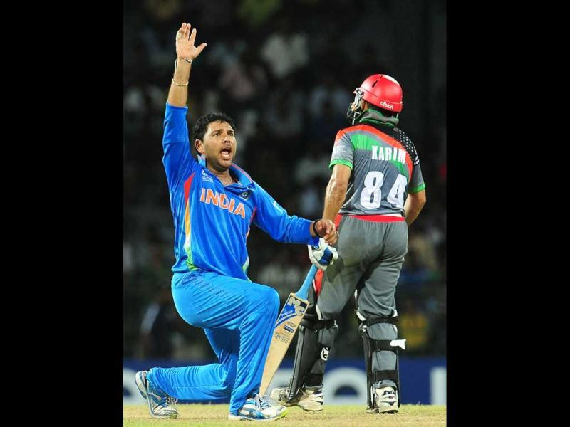 Yuvraj Singh (L) successfully appeals for a Leg Before Wicket (LBW) decision against Afghanistan captain Nawroz Mangal during the ICC Twenty20 Cricket World Cup match between India and Afghanistan at the R Premadasa Stadium in Colombo. AFP/Lakruwan Wanniarachchi