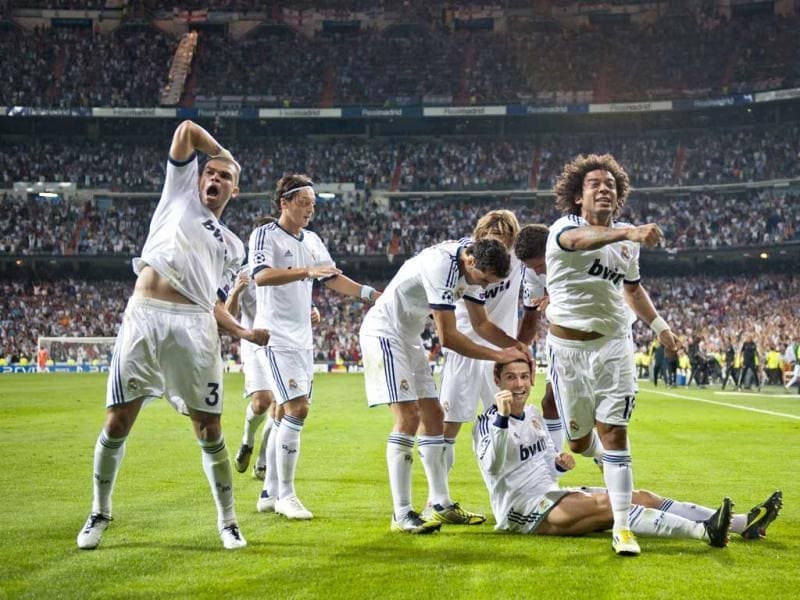 Real Madrid's players celebrate after scoring their second goal against Manchester City during a Champions League Group D soccer match at the Santiago Bernabeu Stadium, in Madrid. AP Photo