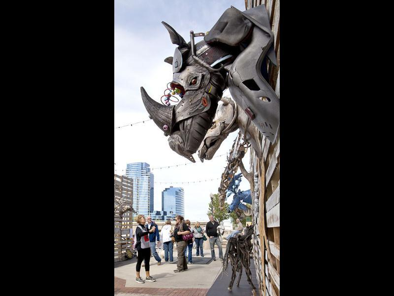 Art-goers look at Terry Brennan's Disposable Game during ArtPrize in Grand Rapids, Michigan. AP Photo