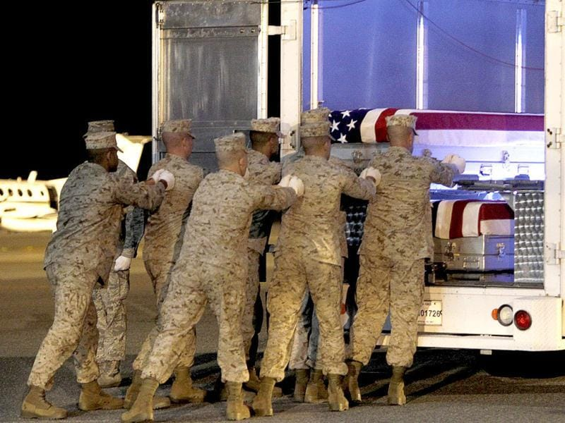 A US Marine Corps carry team moves a transfer case with the remains of fallen Marine Sergeant Bradley W Atwell into the transfer vehicle during a dignified transfer at the Dover Air Force base in Dover, Delaware. Reuters Photo