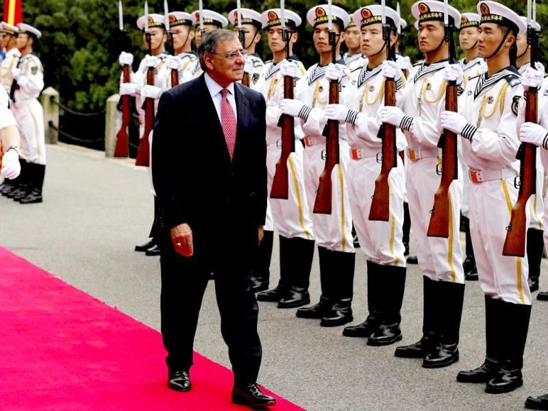 US defense secretary Leon Panetta reviews a naval honor guard at Qingdao, China before touring Chinese naval vessels of the North Sea Fleet. AP Photo