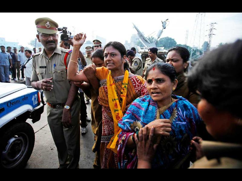 Indian police officers detain activists of Telugu Desam Party during a protest at a bus station in Hyderabad. AP/Mahesh Kumar A