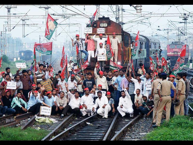 Demonstrators from the Samajwadi Party shout slogans after they stopped a passenger train during a protest against price hikes in fuel and foreign direct investment in retail, near Allahabad railway station. Reuters/Jitendra Prakash