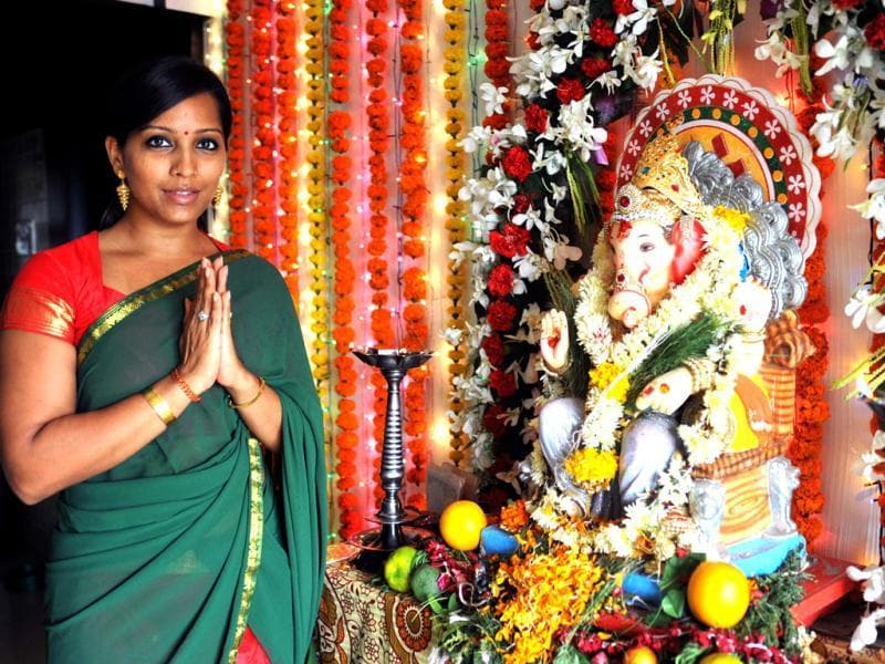 Meghna Naidu poses as she offers prayers to an idol of Hindu God Lord Ganesh during the festival of Ganesh Chaturthi in Mumbai on September 19. (AFP Photo)