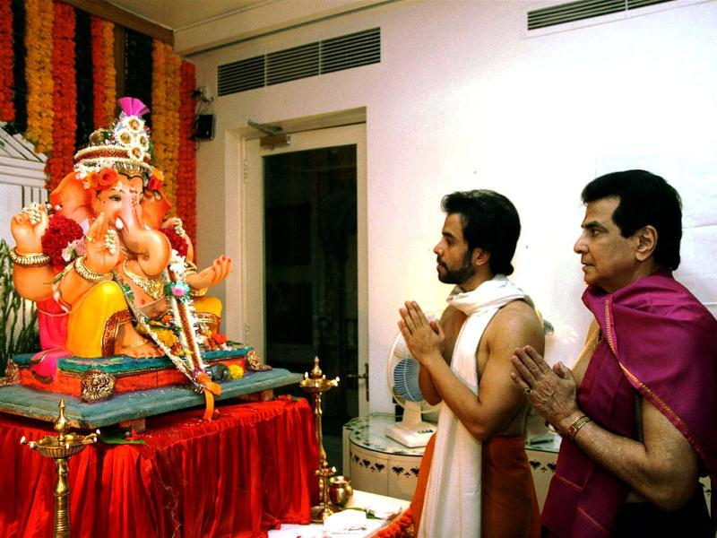 Bollywood actor Jeetendra with son Tusshar Kapoor performs worship of Lord Ganesh on the occasion of Ganesh Chaturthi in Mumbai on September 19. (PTI Photo)