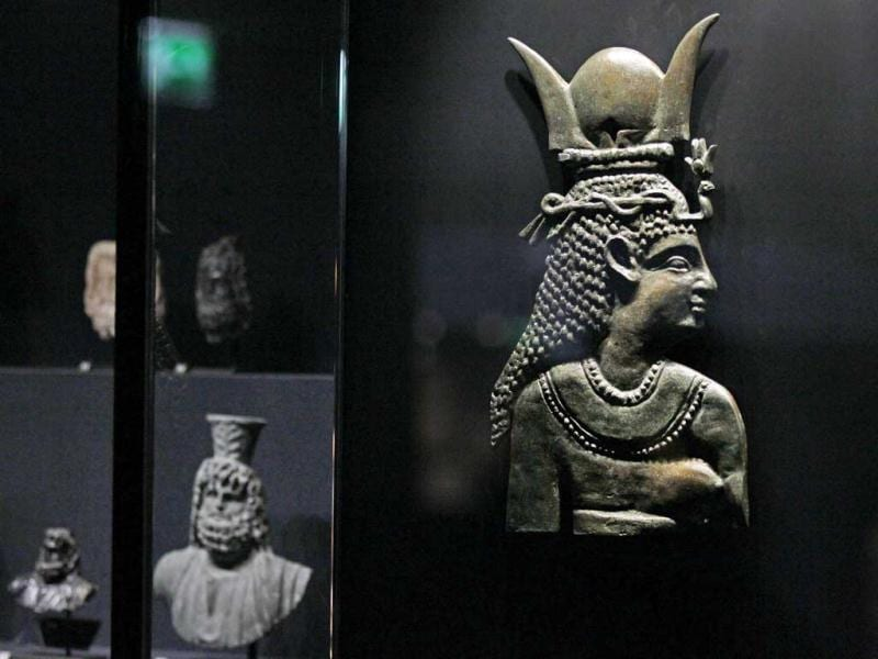 A 1st century BC bronze of Bes, and Egyptian deity worshipped as a protector of households, is displayed at the Louvre museum in Paris. The Louvre museum is unveiling its new wing and galleries dedicated to the arts of Islam, and new dragon-fly shaped building marking the museum's greatest development since the iconic glass pyramid constructed twenty years ago.(AP Photo/Remy de la Mauviniere)
