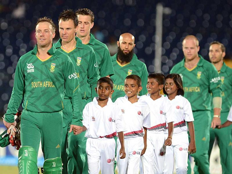 South African captain AB de Villiers (L) and team walk onto the pitch before the start of the ICC Twenty20 Cricket World Cup match between South Africa and Zimbabwe in Hambantota. AFP photo