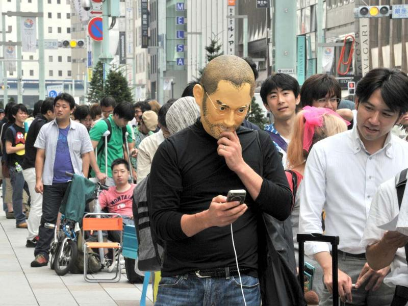 A customer wearing a mask of late Apple founder Steve Jobs lines up to purchase Apple's new iPhone 5 smartphone at the Softbank mobile phone shop in Tokyo. AFP/Yoshikazu Tsuno