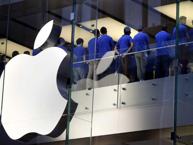 Staff at an Apple store hold a meeting before they open their doors on the day the iPhone 5 went on sale to the public, in central Sydney. Reuters/Tim Wimborne