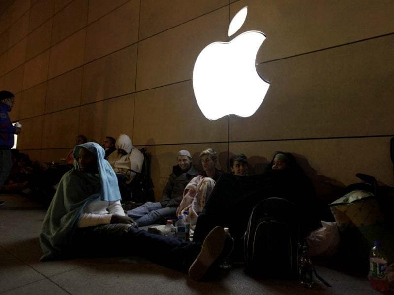 People wait in line to buy Apple Inc's iPhone 5 outside of an Apple store on Michigan avenue in Chicago. AP/Nam Y Huh