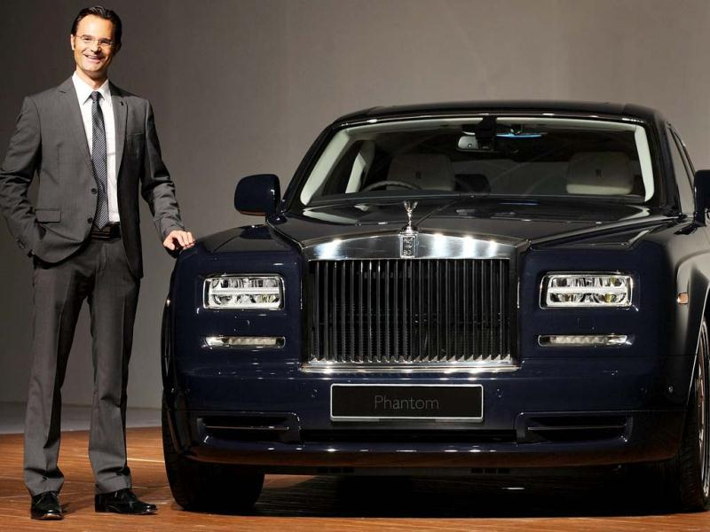 Herfried Hasenoehrl poses with a Rolls Royce Phantom Series II car. AFP Photo