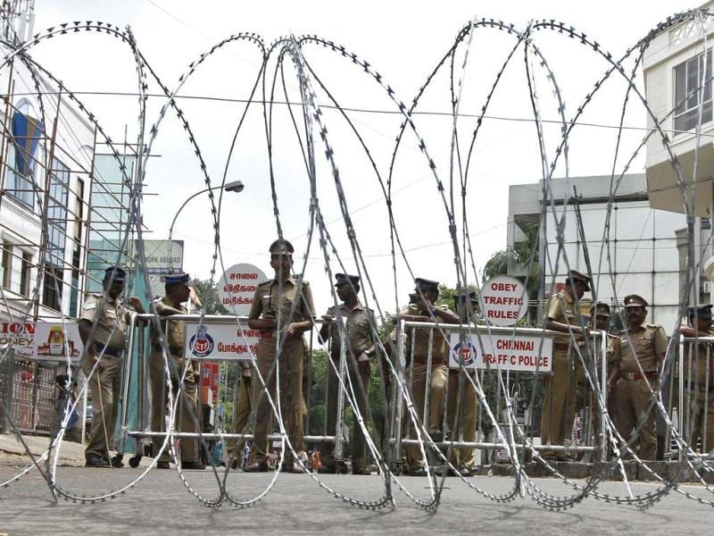 Policemen stand guard behind a coil of concertina wire setup to stop supporters of Viduthalai Chiruthaigal Katchi (VCK), a regional political party, from protesting against Sri Lankan President Mahinda Rajapaksa's visit to India, near the Sri Lankan High Commission in Chennai September. Reuters Photo