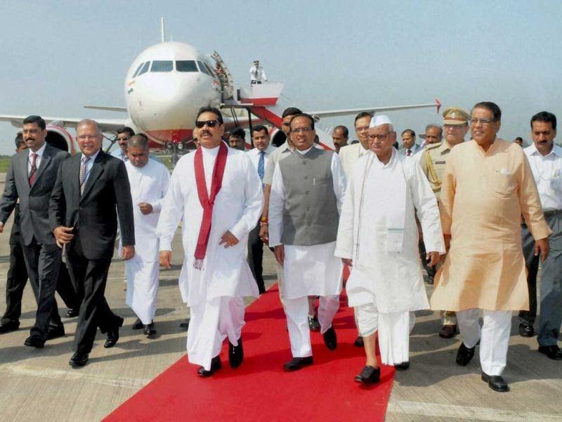 Sri Lankan President Mahinda Rajapaksa being received by Madhya Pradesh Governor Ram Naresh Yadav and CM Shivraj Singh Chauhan on his arrival in Bhopal to attend the foundation stone laying ceremony of Sanchi Buddhist and Indic Studies University. PTI Photo