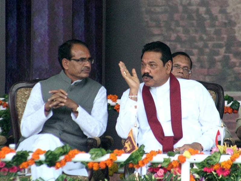 Sri Lankan President Mahinda Rajapaksa (R) gestures as he speaks with the chief minister of Madhya Pradesh Shivraj Singh Chauhan during a Foundation stone laying ceremony at The University of Buddhist and Indic Studies in Sanchi. AFP Photo