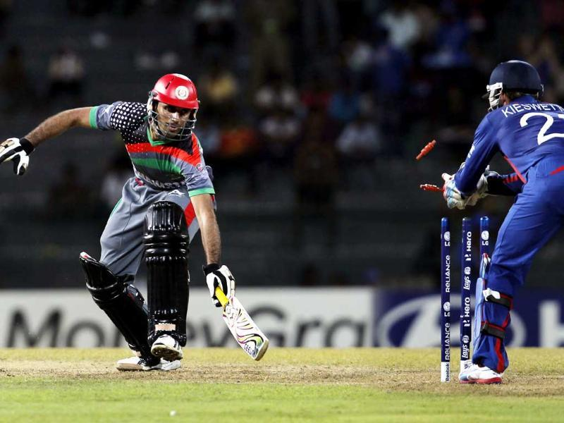 Afghanistan's Dawlat Zadran is stumped by Craig Kieswetter on Samit Patel's delivery during the ICC T20 World Cup cricket match between England and Afghanistan at R Premadasa Stadium in Colombo, Sri Lanka. HT/Ajay Aggarwal