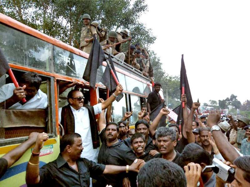 MDMK leader Vaiko and his party workers showing black flags during a protest against the visit of Sri Lankan President Mahinda Rajapaksa, at Badhchicholi village in Madhya Pradesh. PTI Photo