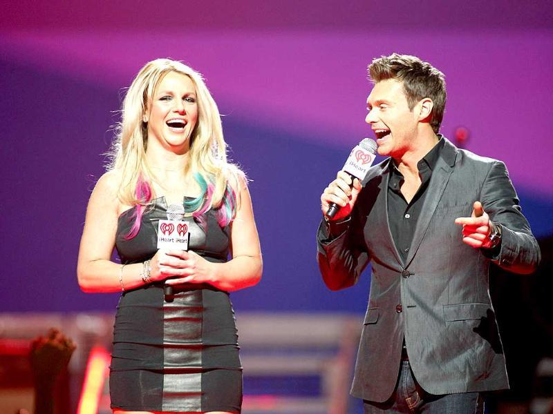 Britney Spears and host Ryan Seacrest introduces a musical group during the 2012 iHeartRadio Music Festival at the MGM Grand Garden Arena in Las Vegas, Nevada. Reuters/Steve Marcus
